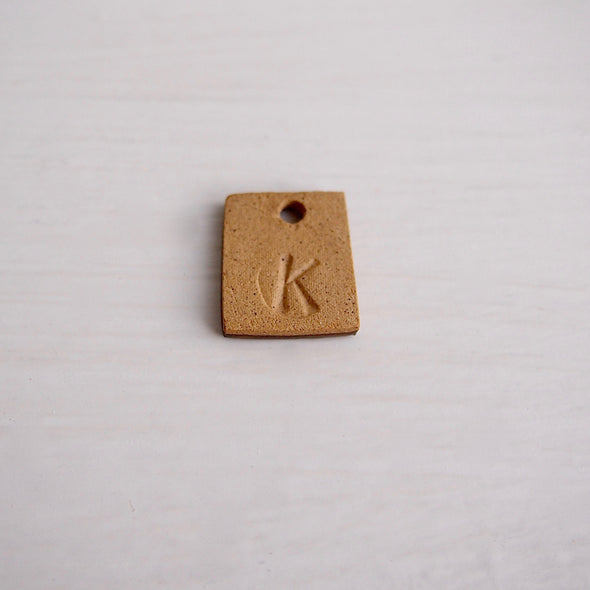Handmade gold ceramic initial necklaces