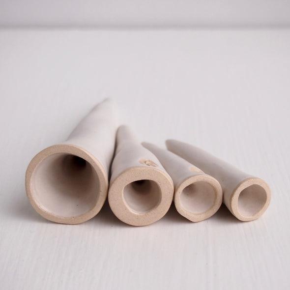 Inside of satin white pottery ring cones