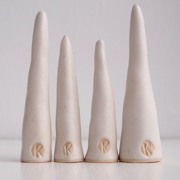 White satin handmade ceramic ring cones