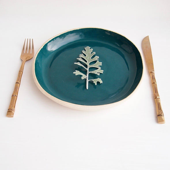 Handmade teal and white pottery plate