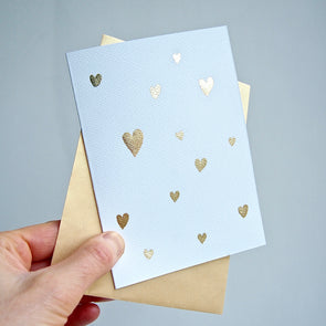 Gold leaf handmade Valentines card with many mini hearts