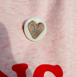 Handmade gold heart ceramic brooch.
