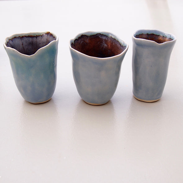 three powder blue mini vases