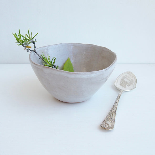 oatmeal ceramic bowl with herbs
