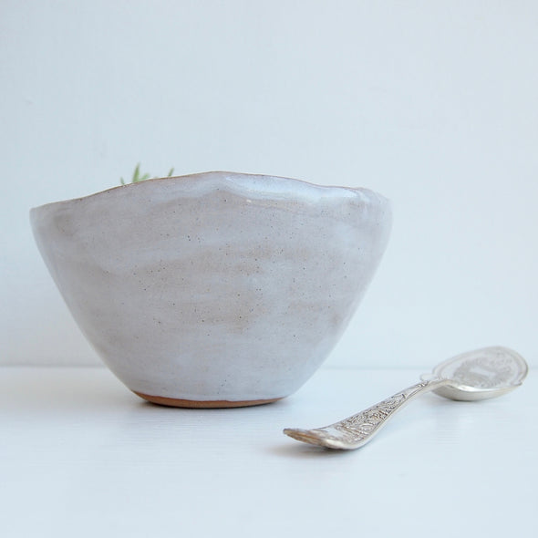 side view oatmeal gloss bowl with spoon