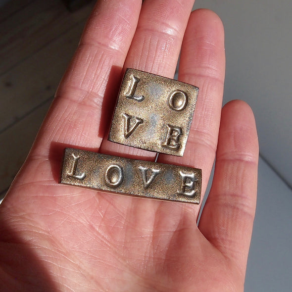 Handmade ceramic gold love brooch