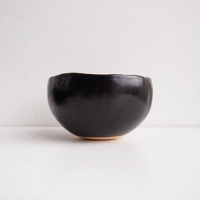 Handmade black satin pottery tea bowl