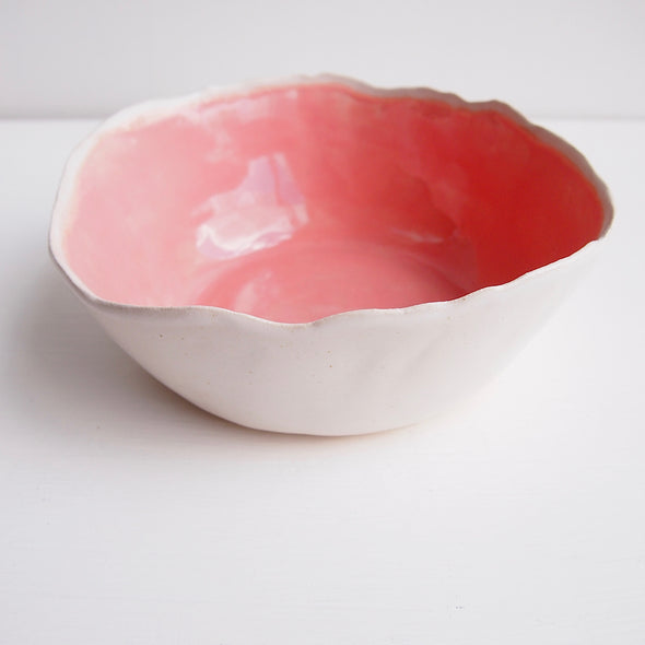 Handmade pink and white pottery serving bowl
