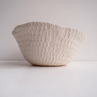 Handmade white ceramic fruit bowl with rectangle texture.