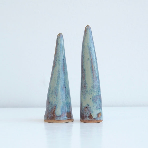 2 small blue/brown ceramic ring cones