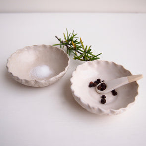 Handmade mini white pottery salt and pepper dish with scalloped edge
