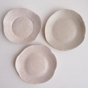 three mini pottery plates