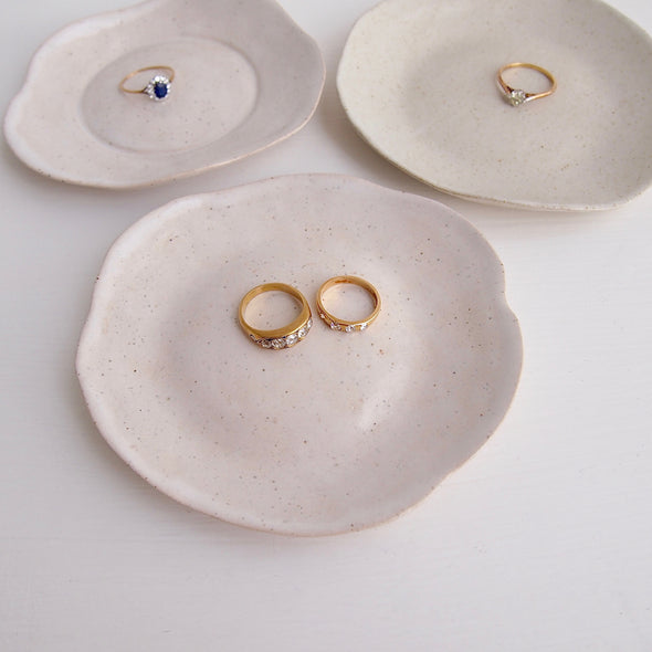 Three mini ceramic plates