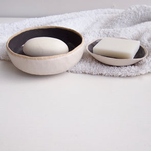 Small and large grey soap dishes
