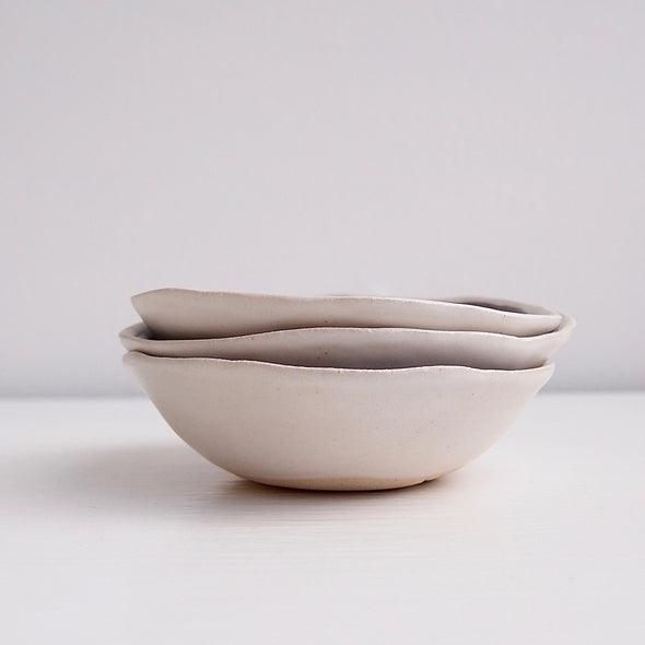side of small grey ceramic soap dishes.