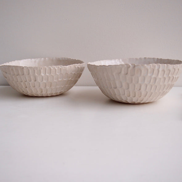 Two textural white salad bowls