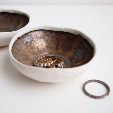 Handmade small gold/black ceramic ring dish