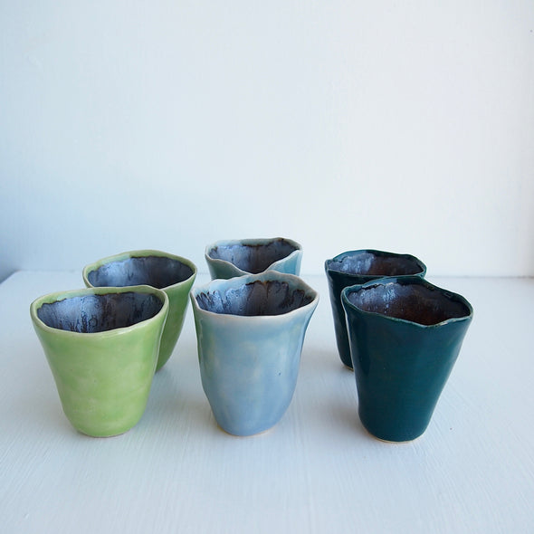 Group of blue and green mini vases