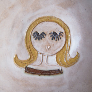 Girl with blonde bob hair mini pottery face plate.