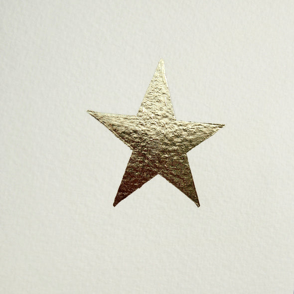 close up of gold leaf christmas star