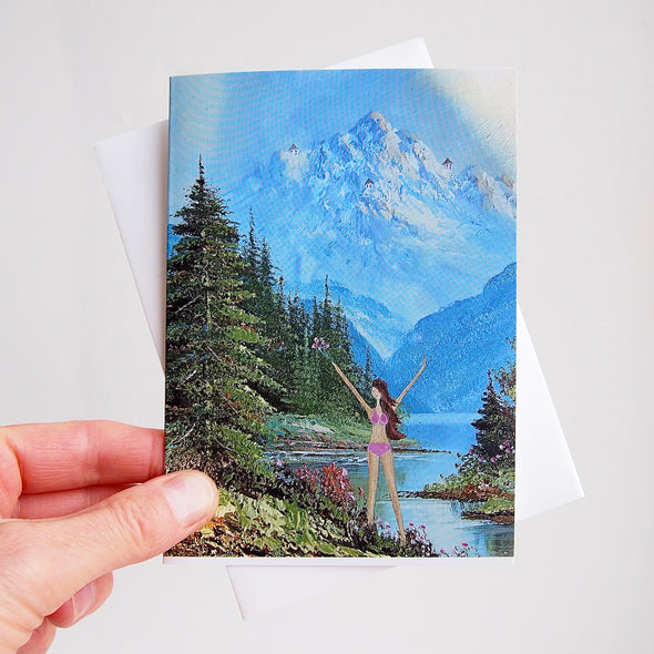 holding girl in the mountains greetings card