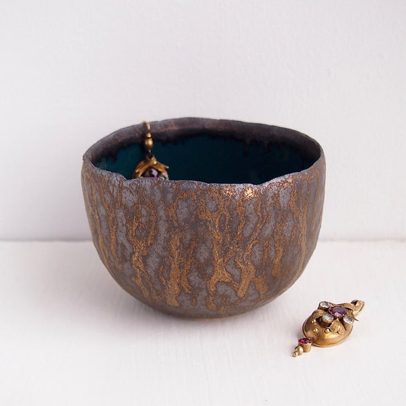 Teal and gold pottery ring bowl with earrings