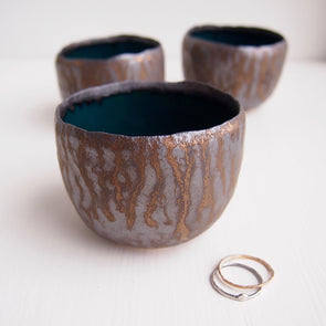 Teal and gold pottery ring bowls