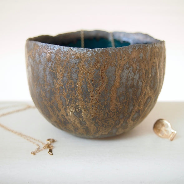 Teal and gold pottery ring bowl with jewellery