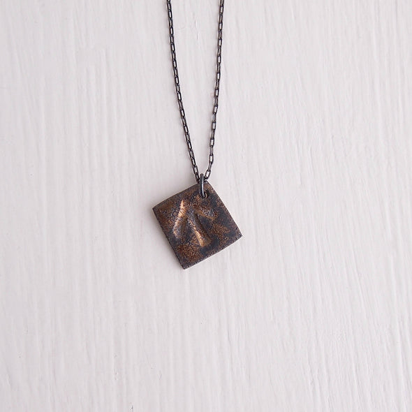 Gold black ceramic arrow necklace