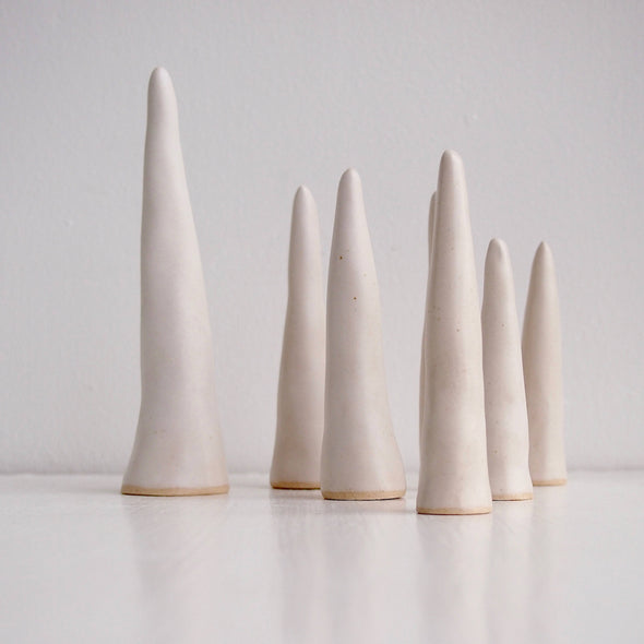 Group of Satin white pottery ring cones