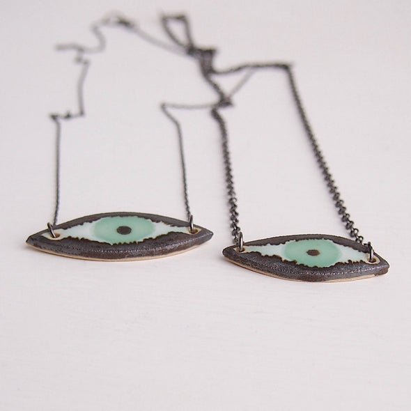 Handmade turquoise ceramic eye necklace