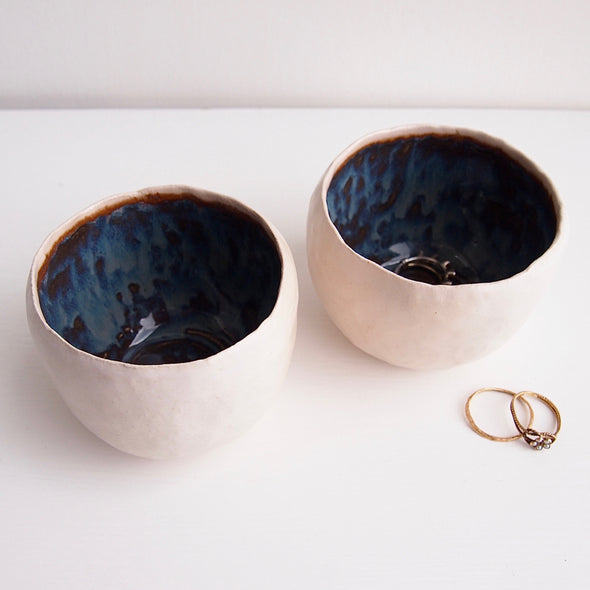 Handmade ring bowl in blue and brown.