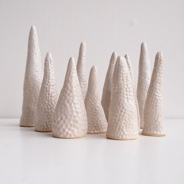 Group of white ceramic circle texture ring cones