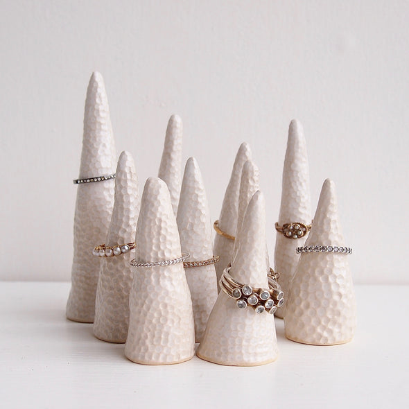Group of white ceramic circle texture ring cones with rings