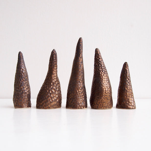 Handmade black/gold textural ceramic ring cones