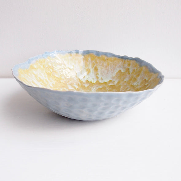 Handmade pottery serving bowl in powder blue and yellow