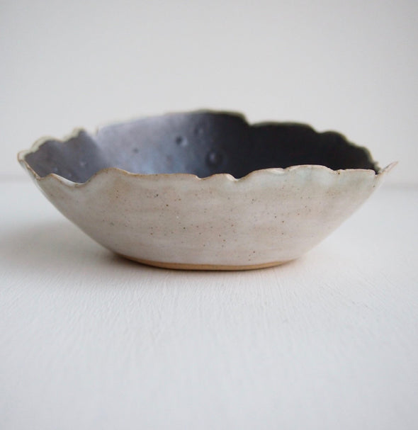 Handmade metallic black and white pottery ring dish