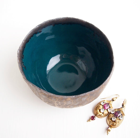 inside of Teal and gold pottery ring bowls