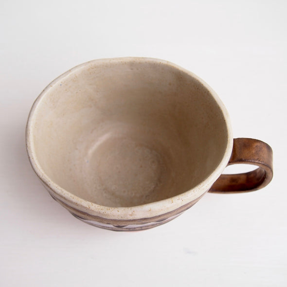 Handmade pottery mug with gold, orange and grey.