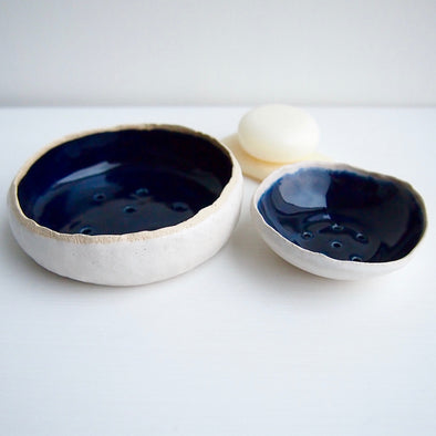 navy and white pottery soap dishes