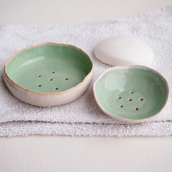 two turquoise soap dishes