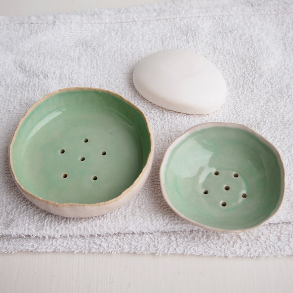 two turquoise ceramic soap dishes