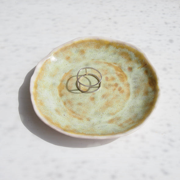 yellow pottery ring dish with ring