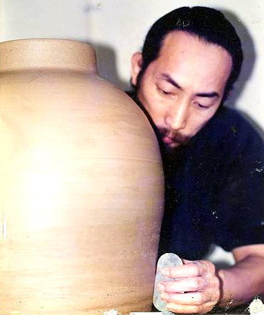 Artist Joseph Chiang working in South Africa on a large ceramic piece.