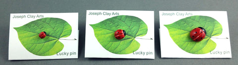 Lucky porcelain ladybug pins by Joseph Chiang