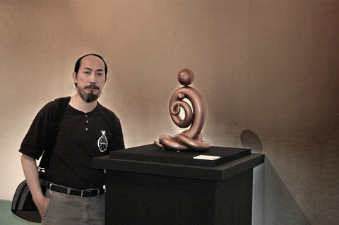 Artist Joseph Chiang with his Line of Love Sculpture Exhibition at Taipa-Houses Museum, Macau, 2006