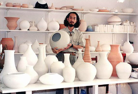 Artist Joseph Chiang with a collection of his larger ceramic pieces in South Africa.
