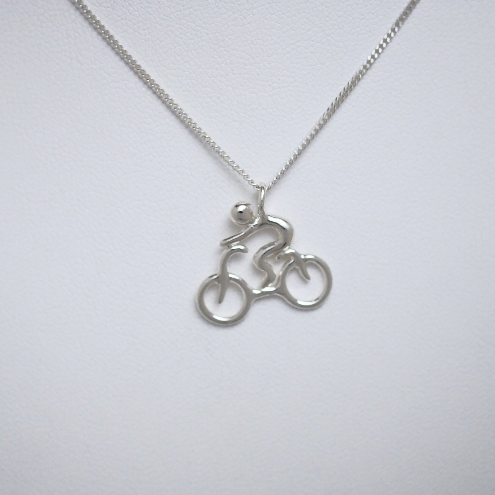 Cyclist sterling silver pendant by Joseph Chiang