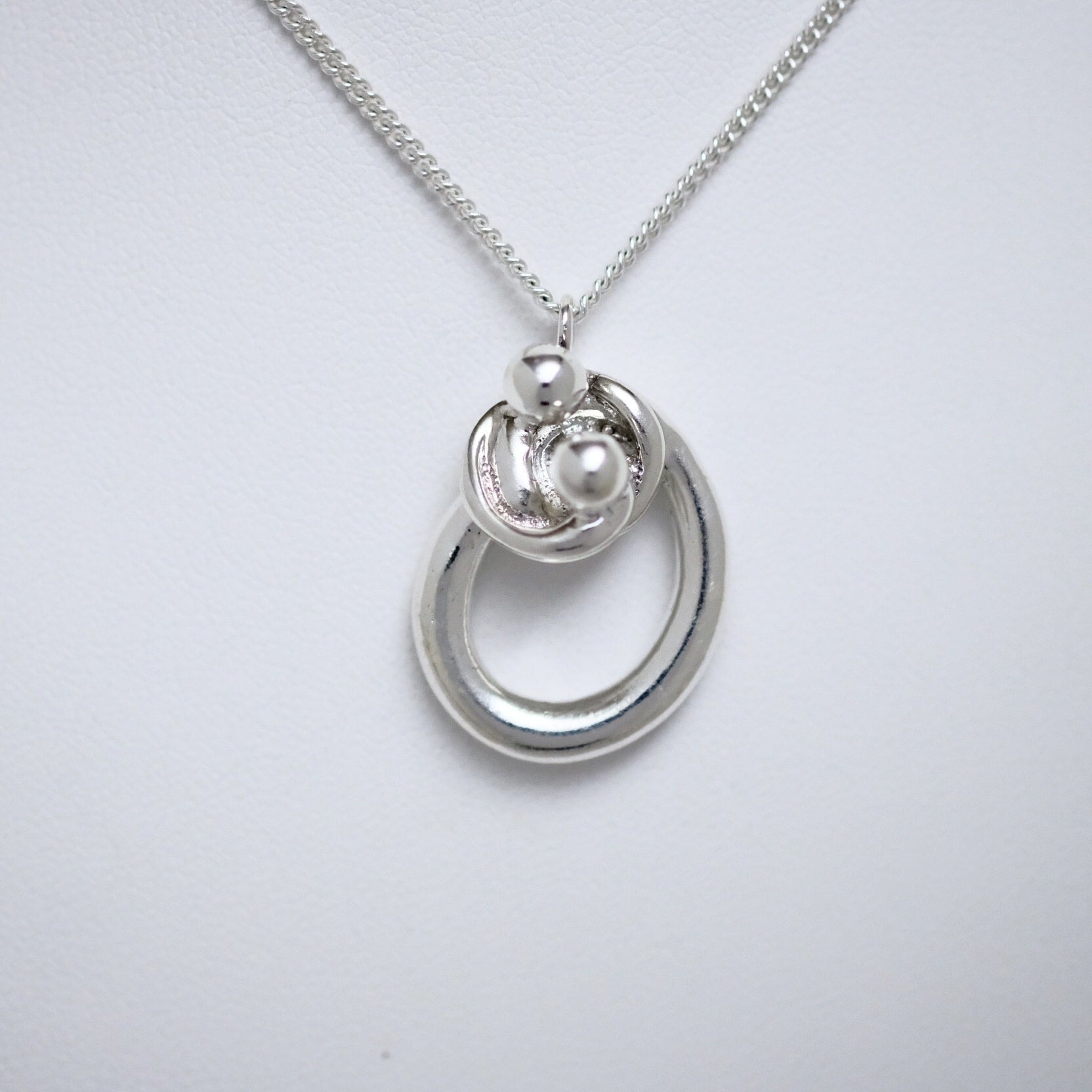 Entangle single size sterling silver pendant by Joseph Chiang