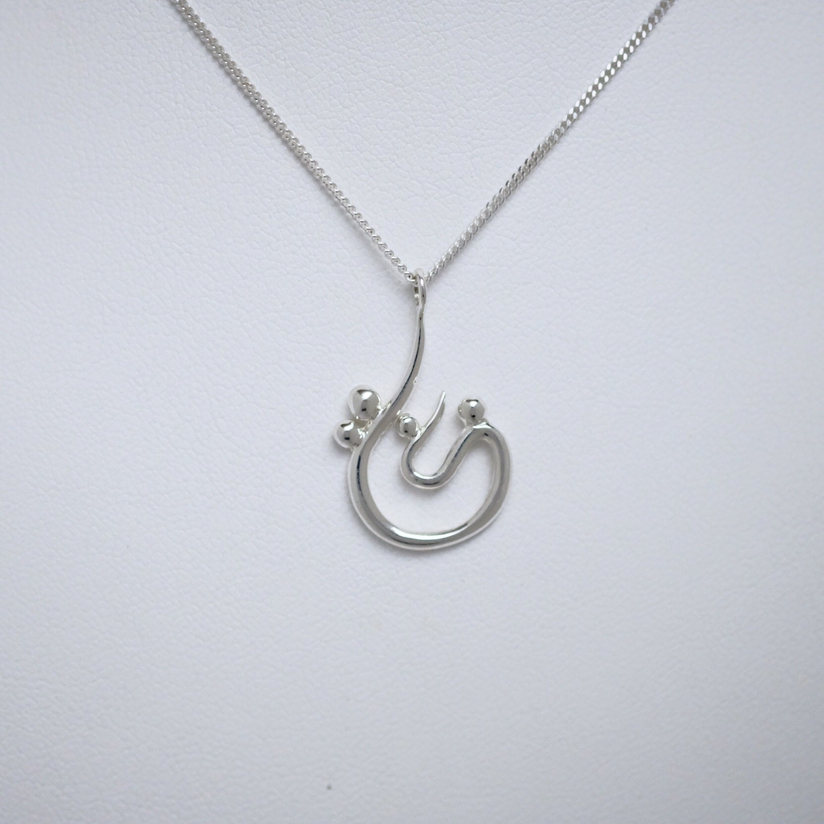 Family of Four small teardrop pendant Line of Love Jewellery by Joseph Chiang